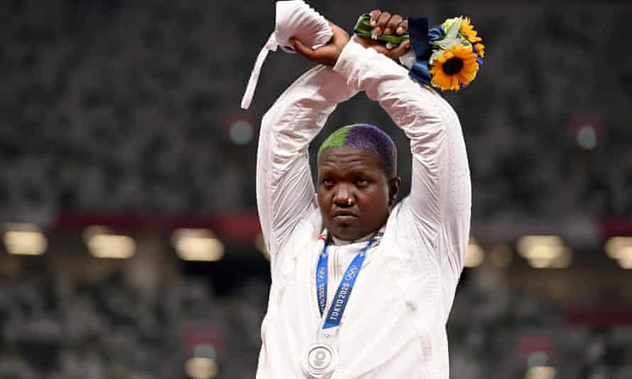 Raven Saunders gestures on the podium after winning silver in the women's shot-put at the Tokyo Olympics.