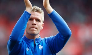 Jonas Lössl applauds Huddersfield fans after their final game of the season, a draw at Southampton when he sat on the bench.