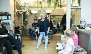 Natalie Power, owner of Dylan Robert Hair and Beauty, at her shop with her daughter, two grandchildren and staff.