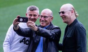 Ole Gunnar Solskjær takes a selfie with Joel Glazer (centre) and Avram Glazer (right) in April 2019.