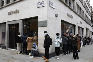People queue outside a Hermes store in Mayfair in London, Monday, on 12 April, 2021.
