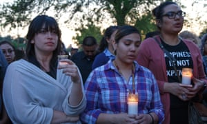 Attendees at a candlelight vigil at Our Lady of the Assumption church in San Bernardino, California, on Monday to mourn the victims of a deadly shooting at a local elementary school.