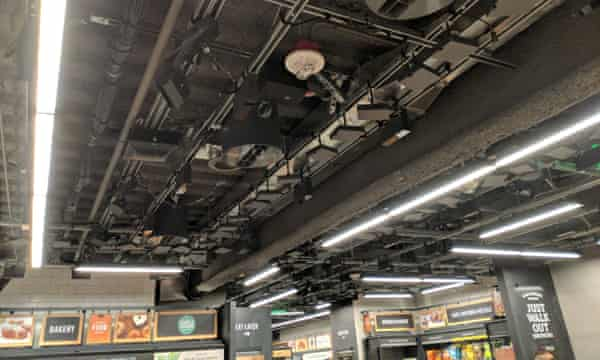 A bank of cameras and other sensors in the ceiling tracks shoppers through the store.