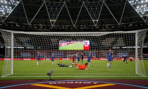 Andriy Yarmolenko scores the third goal for West Ham late in their match against Chelsea.