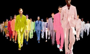 various catwalk suits arranged in a colourful line