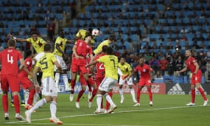 Yerry Mina rises above England's Harry Maguire to head Colombia's injury time equaliser forcing their World Cup round of 16 tie to penalties.