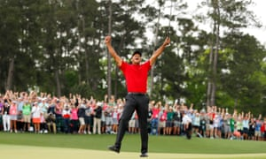 Woods celebrates after he sinks his winning putt at Augusta National.