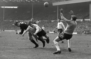 Two days later England keeper Gordon Banks and defender Jackie Charlton combine to foil Scotland's Billy McNeill during their 2-2 at Wembley