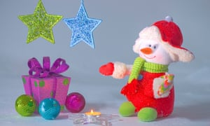 colorful christmas decorations and a wrapped gift box