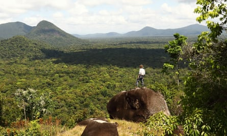 Kevin Rushby looking from Awarmie Hill over the jungles of Rewa, Guyana