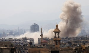 Smoke billows after a reported airstrike in rebel-held parts of Jobar, on the eastern outskirts of Damascus