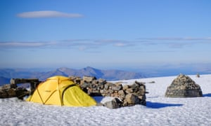 Camping on the snowcapped summit of Ben Nevis.