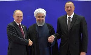 Vladimir Putin, Iranian president Hassan Rouhani and Azerbaijan's President Ilham Aliyev in Tehran on Wednesday.
