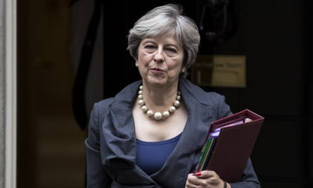 Theresa May leaves 10 Downing Street to attend prime minister's questions on 11 October 2017.