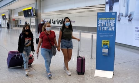 Passengers on a flight from Madrid arrive at Heathrow airport on Sunday.