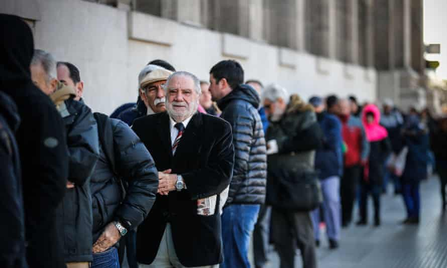 People line up at a bank after the Argentinian government imposed currency controls.