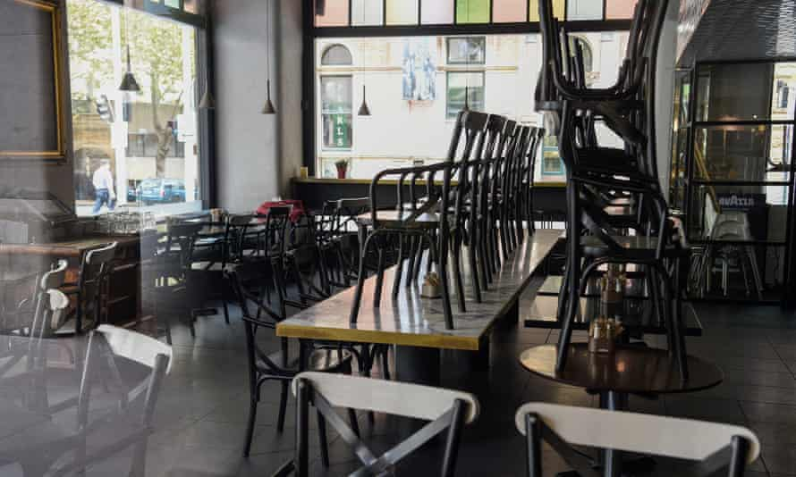 Stacked tables and chairs in a closed cafe in Sydney, Australia