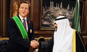 David Cameron receiving the King Abdullah Decoration One from King Abdullah of Saudi Arabia in 2012.