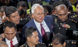 Former Malaysian Prime Minister Najib Razak arrives at court in Kuala Lumpur on Wednesday.