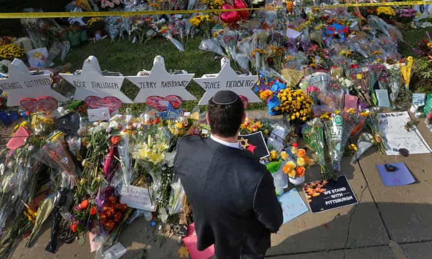 A man prays at a makeshift memorial outside the Tree of Life synagogue in Pittsburgh, Pennsylvania on 31 October.