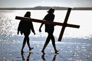 People celebrate Easter by crossing the tidal causeway to Holy Island, near Berwick Upon Tweed, England