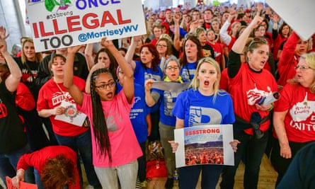 West Virginia teachers hold a rally outside the senate chambers in Charleston last month. Strike leaders from Oklahoma, Arizona and Kentucky have been in contact with their West Virginia peers to learn lessons.