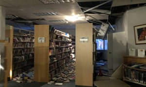 Books and ceiling tiles litter the floor of the Mat-Su college's library in Anchorage following the earthquakes.