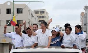 Opposition Guillermo Lasso gestures during an election rally in Santa Elena, Ecuador.