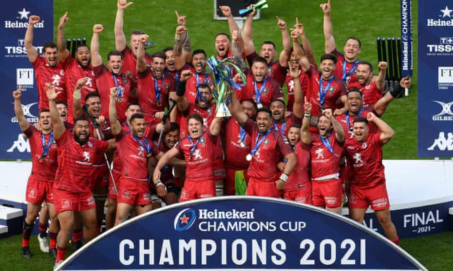 Antoine Dupont and Jerome Kaino lift the Champions Cup trophy for Toulouse.