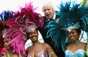 Boris Johnson when he was mayor of London with members of the carnival mas band Genesis.