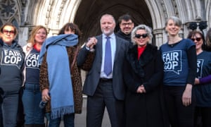 Harry Miller stands outside the high court with supporters, including the comedy writer Graham Linehan