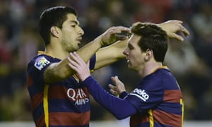 Barcelona's Messi with Luis Suarez after he scored another goal.