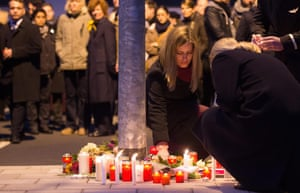 epa04677569 Employees of Germanwings and Lufthansa lay flowers and candles outside the headquarters of Germanwings in Cologne, Germany, 24 March 2015. Germanwings Flight 4U 9525 from Barcelona to Duesseldorf crashed on 24 March over the Southern Alps in France with at least 140 passengers and six crew on board. EPA/Marius Becker