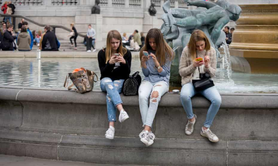 Teenagers on their phones