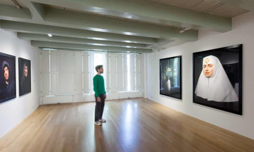 A guest admires the interior of Huis Marseille, Amsterdam