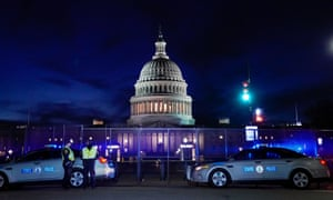 The US Capitol is seen behind heavy-duty security fencing on Thursday.
