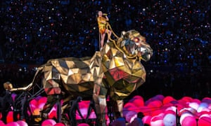 A giant tiger carries Katy Perry into the stadium for her to belt out her hit single Roar