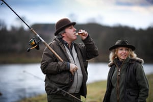 A fisherman drinks whisky on the opening day