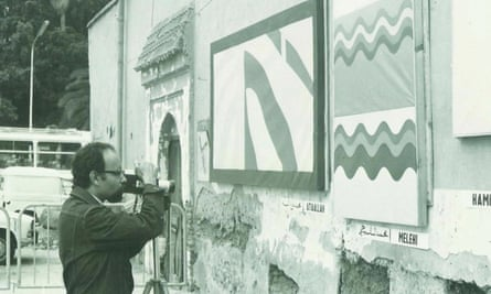 Mohamed Melehi taking photos of the collective street exhibition in Jemaa el-Fnaa Square, Marrakech, in 1969