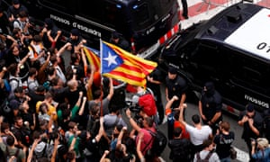 Protesters wave a Catalan pro-independence 'Estelada' flag during a demonstration