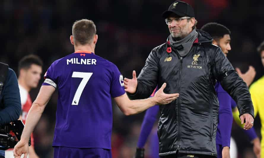 Jurgen Klopp greets James Milner after the final whistle at the Emirates
