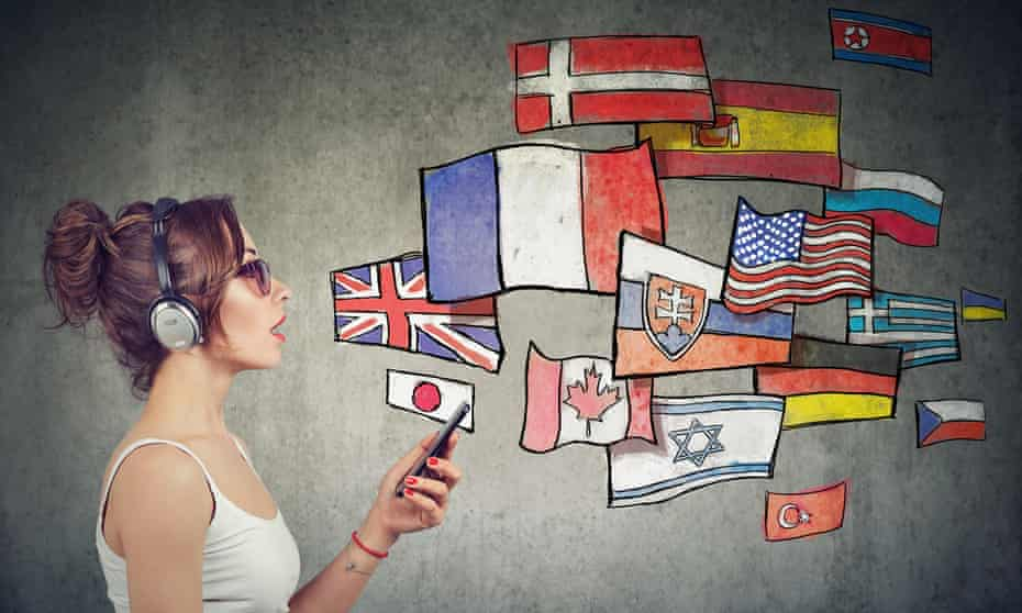 Young woman in headphones with smartphone and flags