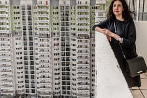 Vivian Del Rio, Photographer and Artist on the balcony of her new apartment block , built on the site of her old neighbourhood.