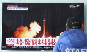 A man in South Korea watches a TV report about the latest missile launch by Pyongyang.