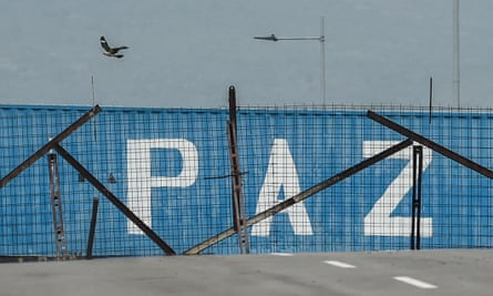 The word 'Peace' is written on one of the containers preventing access to the country from Colombia.