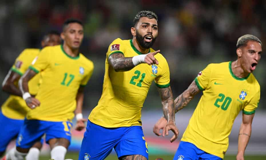 Gabriel Barbosa (centre) celebrates his penalty with Raphinha (No 17) and Antony (No 20).