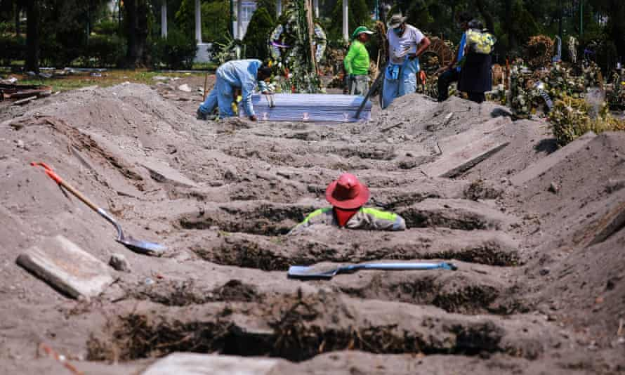 Cemetery workers bury a presumed victim of Covid-19 in Mexico City.