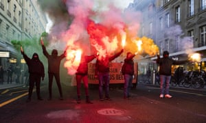 Protesters burn fireworks during a demonstration against the World Economic Forum in Bern, Switzerland