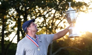 Job done: Bryson DeChambeau holds the US Open trophy aloft after securing his first major title.