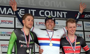 Alex Dowsett, centre,  celebrates winning the Men's time trial with runner-up  James Gullen, left, and third placed Ryan Perry.